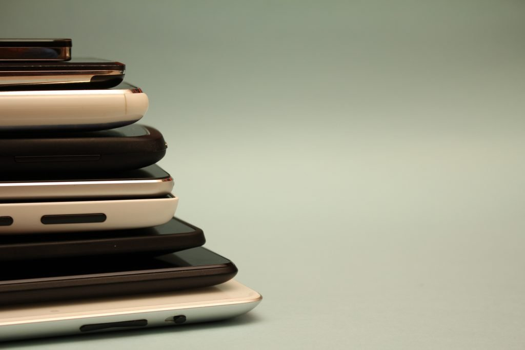 Stack of mobile phones and tablets